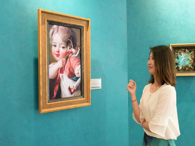 友達攜手奇美博物館 獨步全球A.R.T.先進抗反光顯示技術 真實還原數位畫作細膩質感。(友達提供)